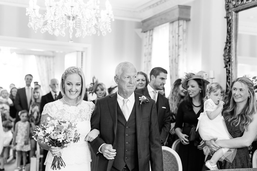 Bride walking into wedding ceremony at The Mansion House Tunbridge Wells