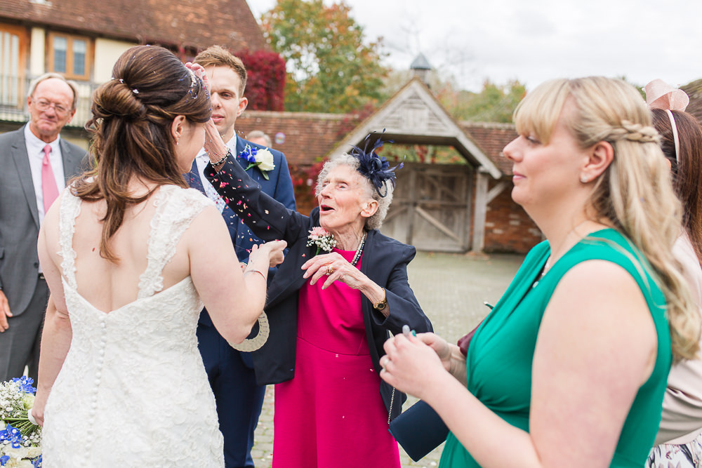 Grandma throwing confetti over Bride