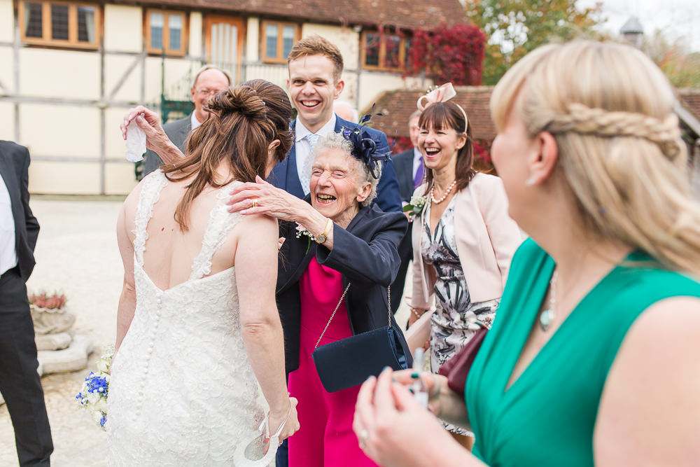 Grandma hugging Bride