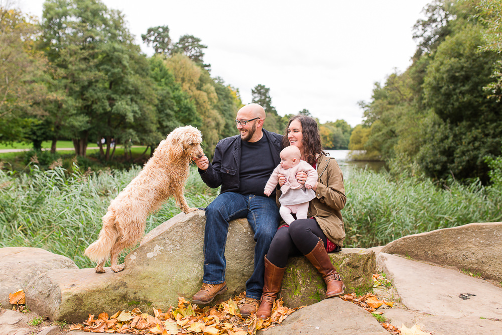Natural family photo with baby and dog outside
