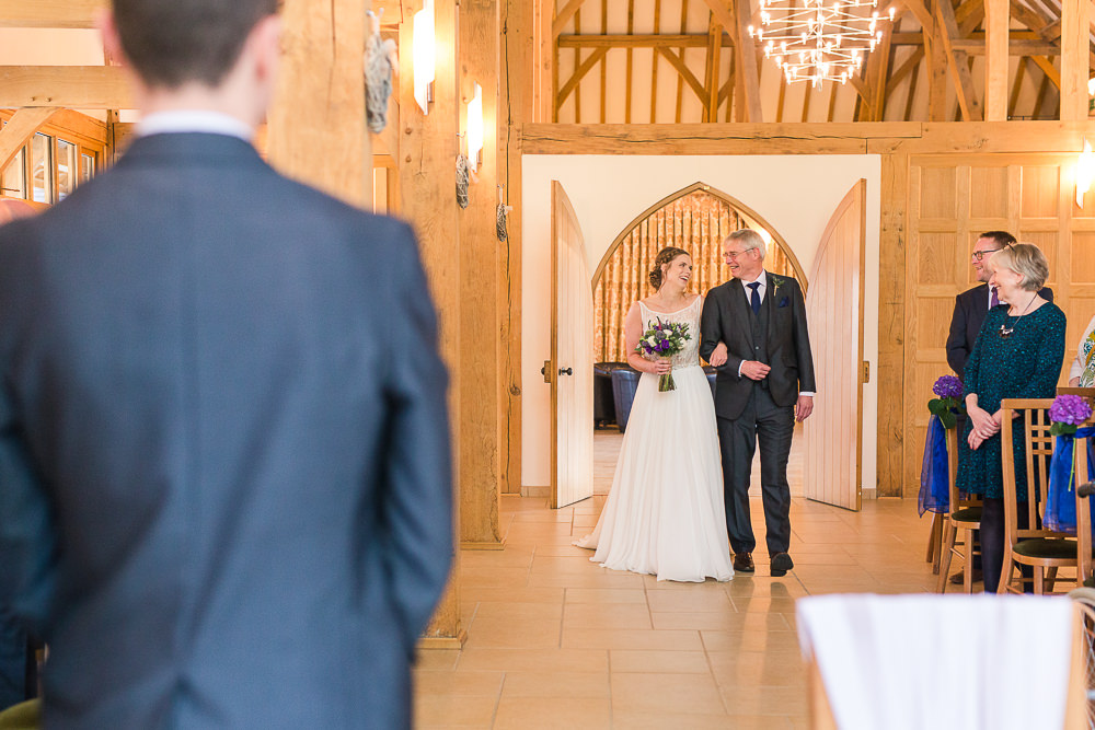 Bride walks down aisle at Rivervale Barn Wedding