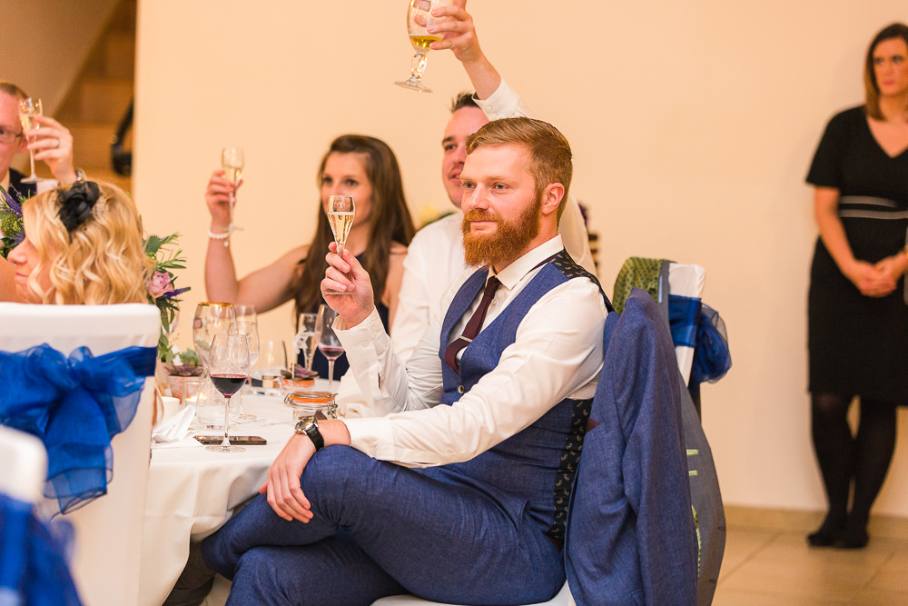 Guests reaction to speeches at Rivervale Barn wedding