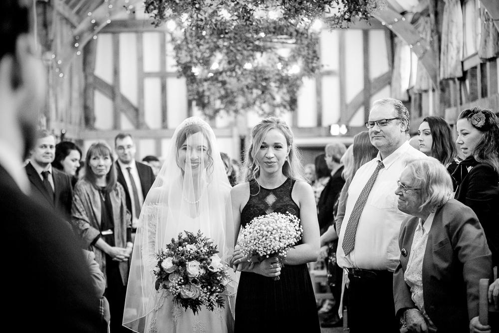 Bride walks down the aisle at Gate Street Barn wedding