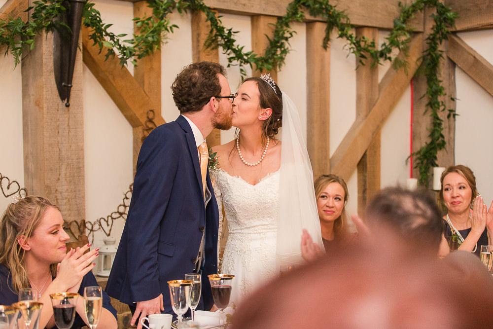 bride and groom kiss at Gate Street Barn wedding