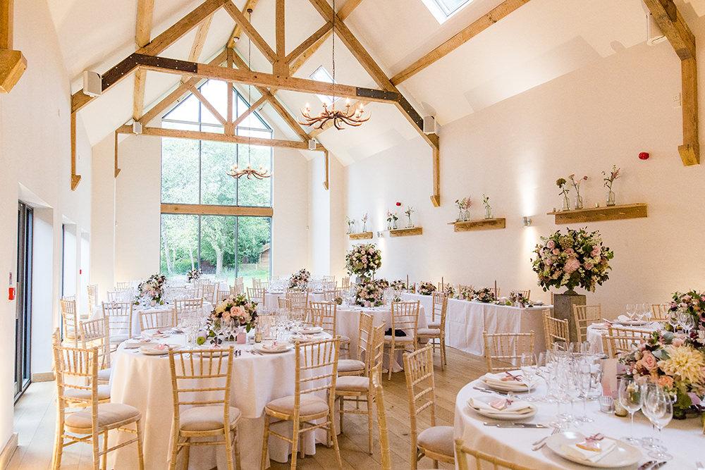 wedding breakfast room set up at Millbridge Court