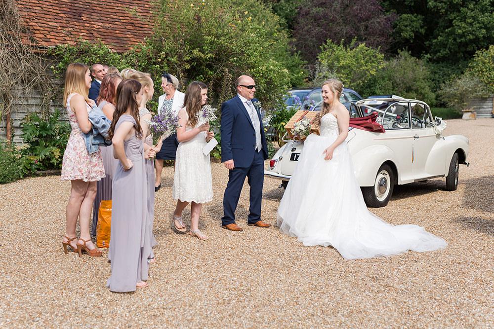 bride leaving form ceremony in morris minor