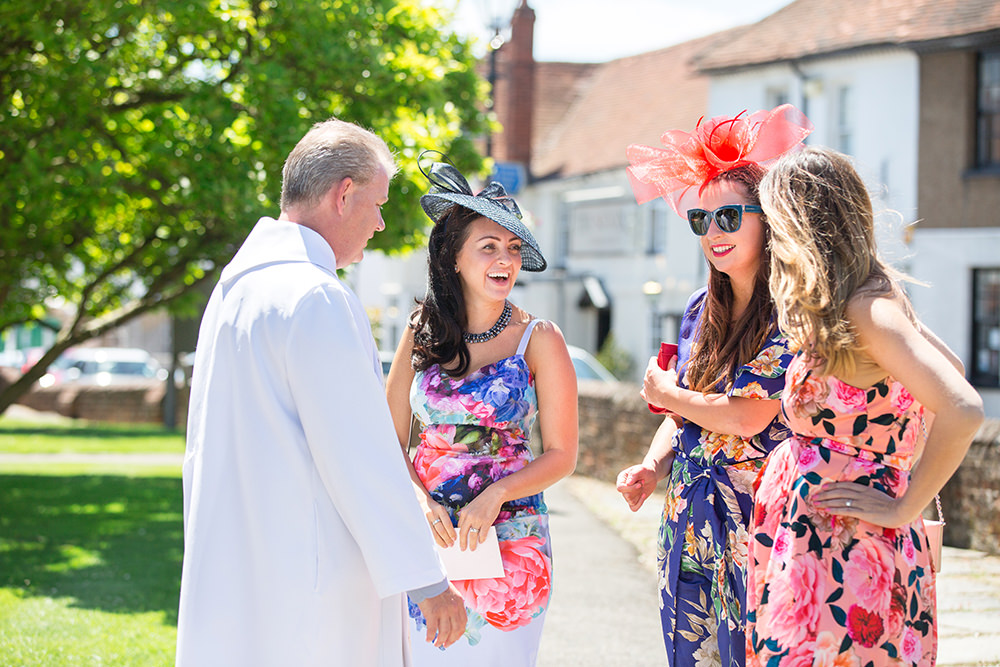 guests arrive at church in Chobham for wedding ceremony