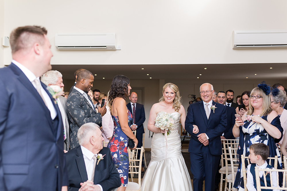 Bride walking down the aisle at Millbridge Court wedding