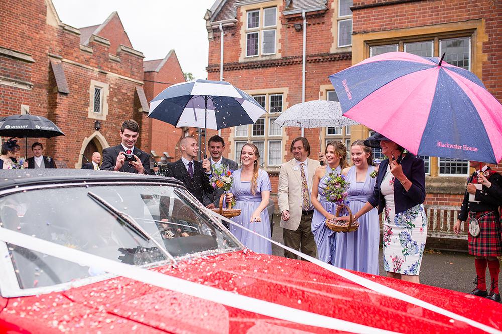 rainy wedding confetti throwing