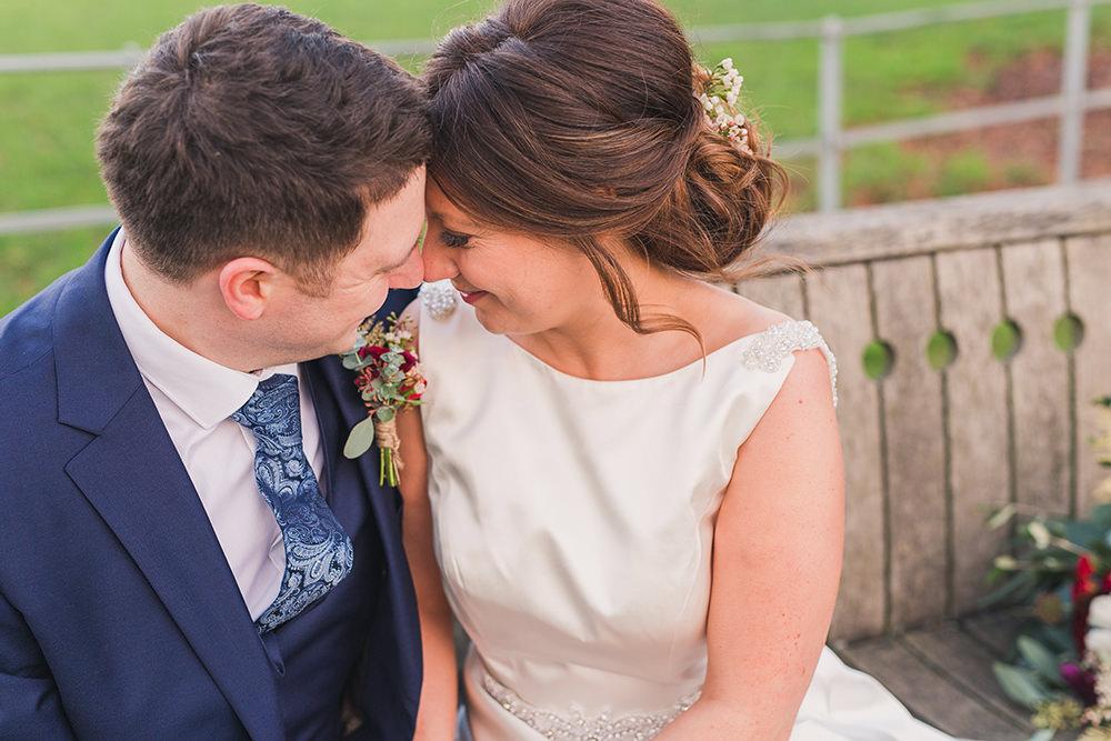 bride and groom at winter Gate Street Barn wedding
