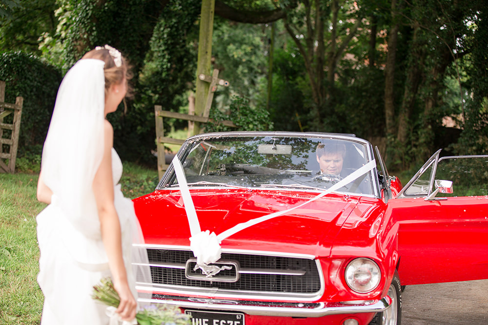 Bride and Groom in vintage Ford Mustang