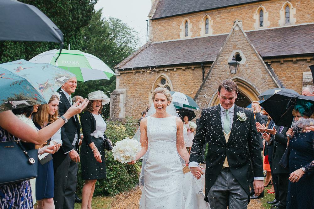 confetti at a rainy wedding