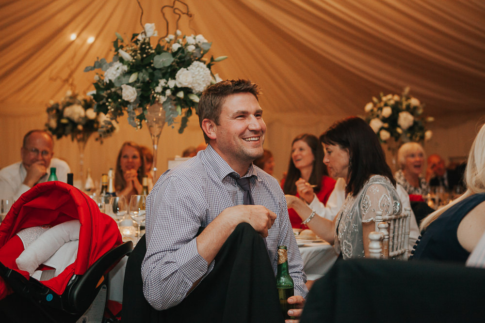 guests reacting to wedding speeches