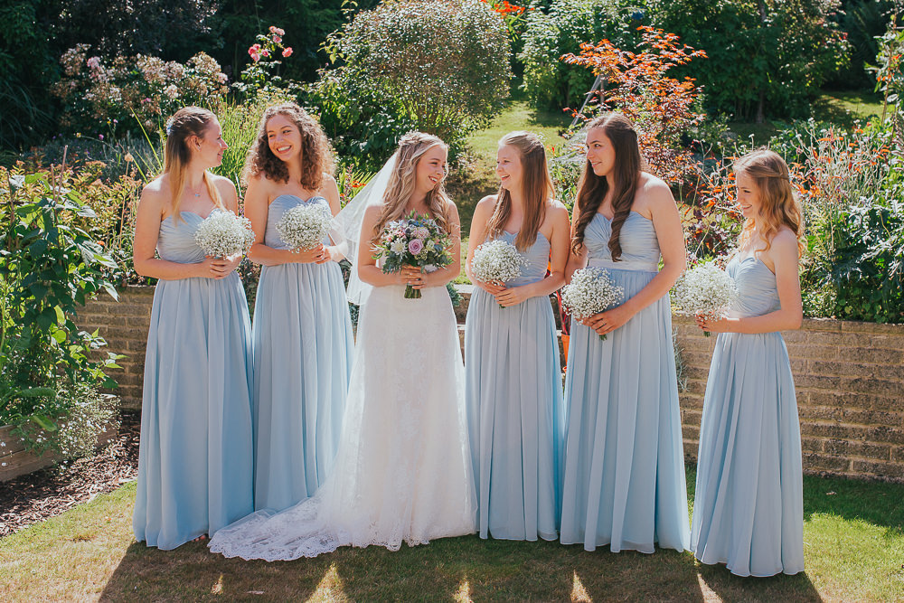 natural photo of bride with bridesmaids