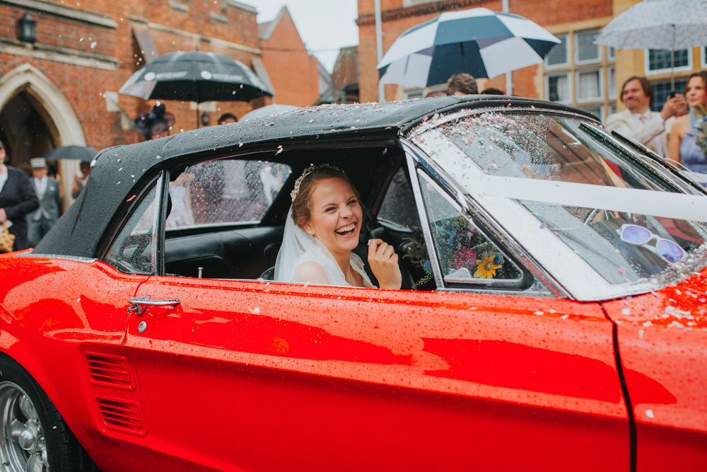 Bride in red Ford Mustang