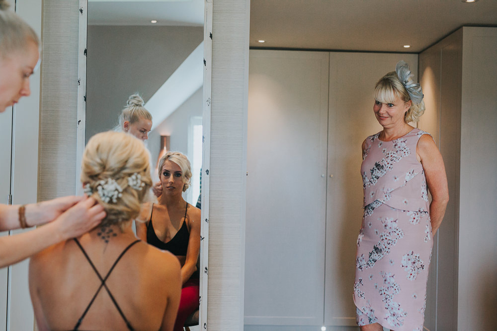 mother of bride watching daughter on wedding day