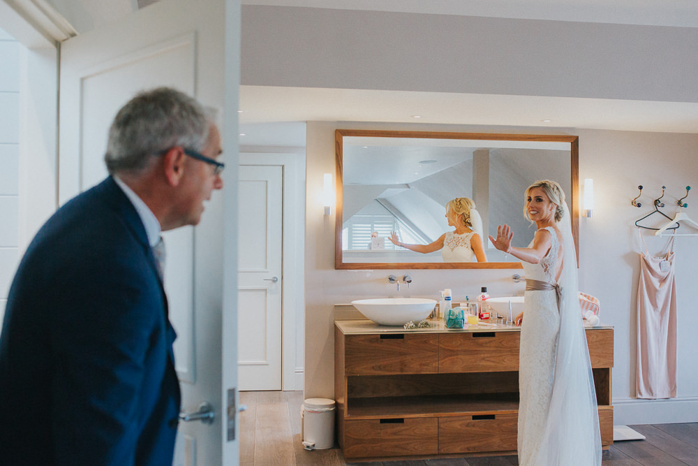 father of bride seeing daughter on wedding day