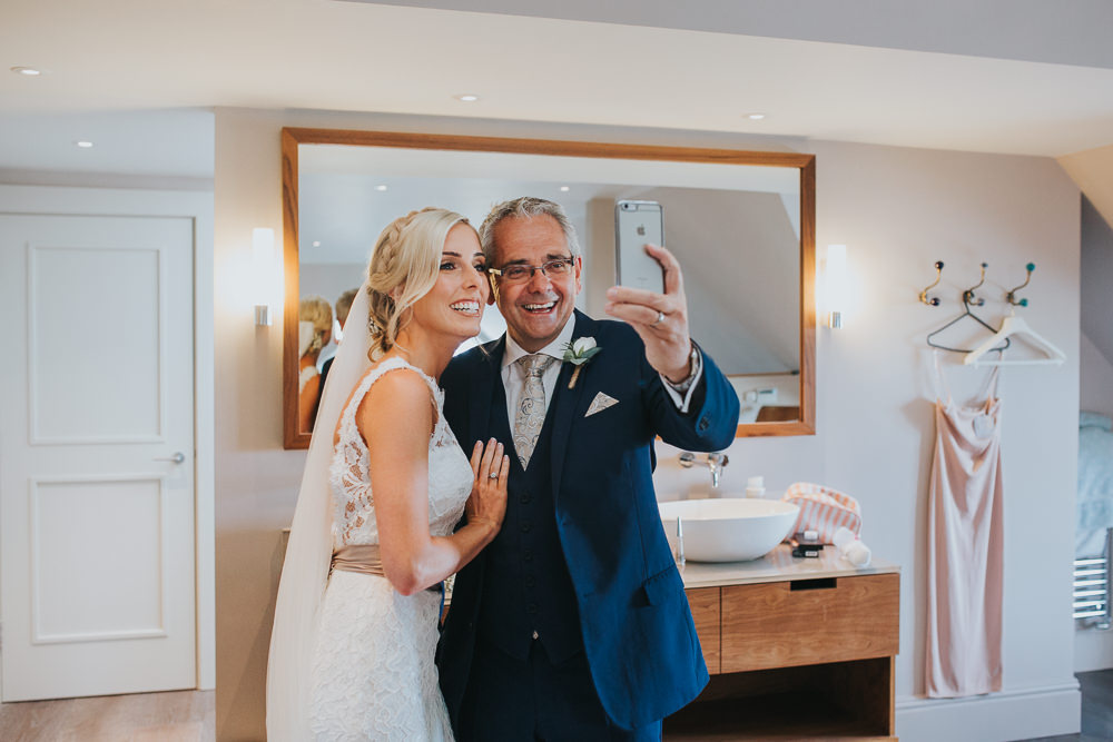 bride and father taking a selfie