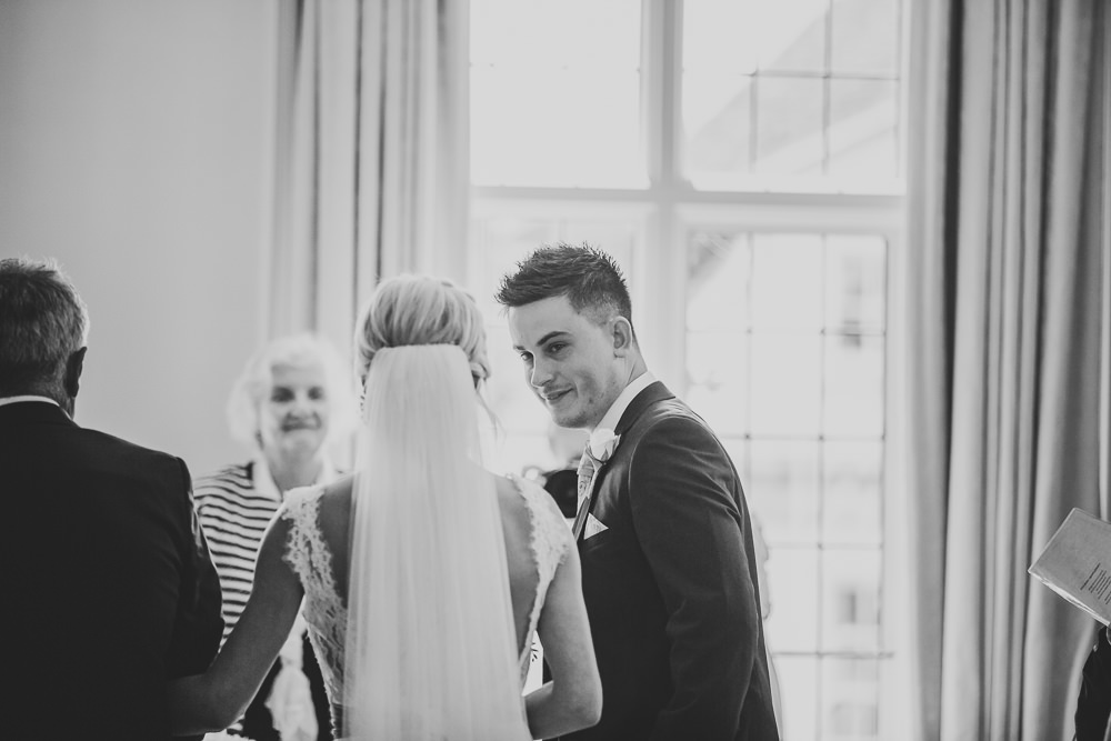 emotional groom sees bride for first time on wedding day at Edes House Chichester