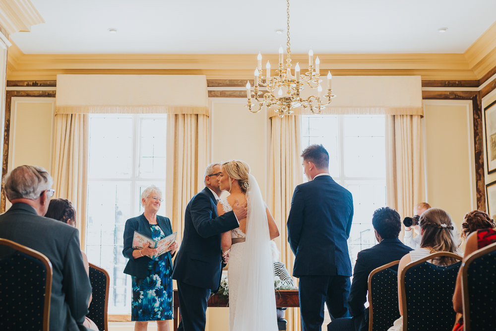 father gives bride away at Edes House wedding