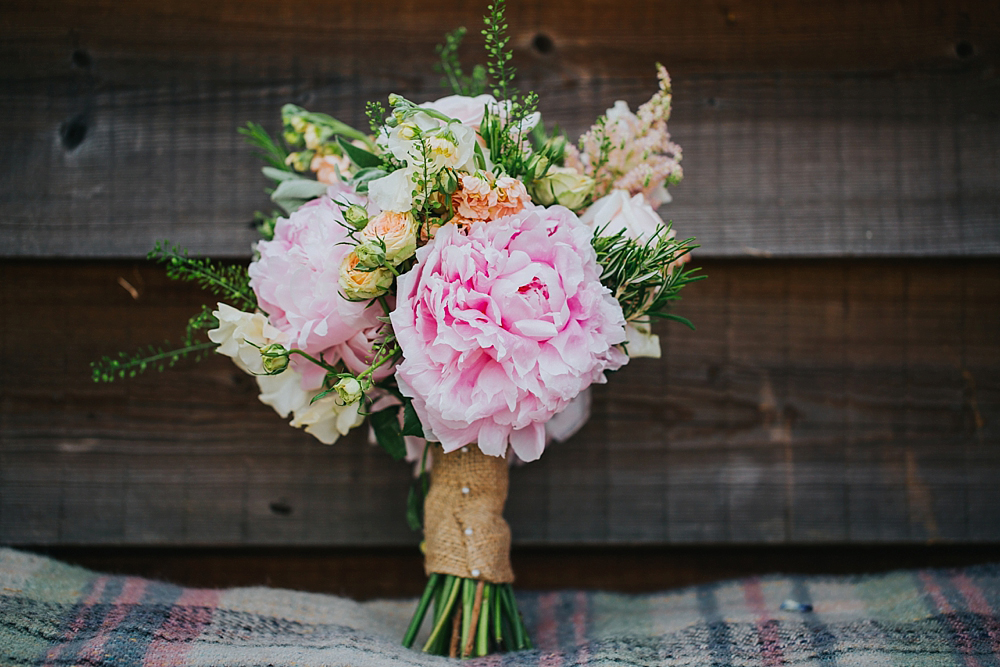 a rustic wedding bouquet with peony