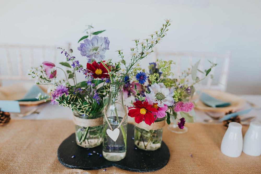 wild flowers in old jars, wedding DIY