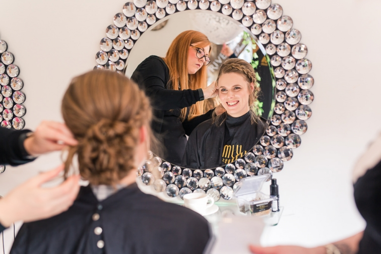Bride getting hair done at Rivervale Barn wedding